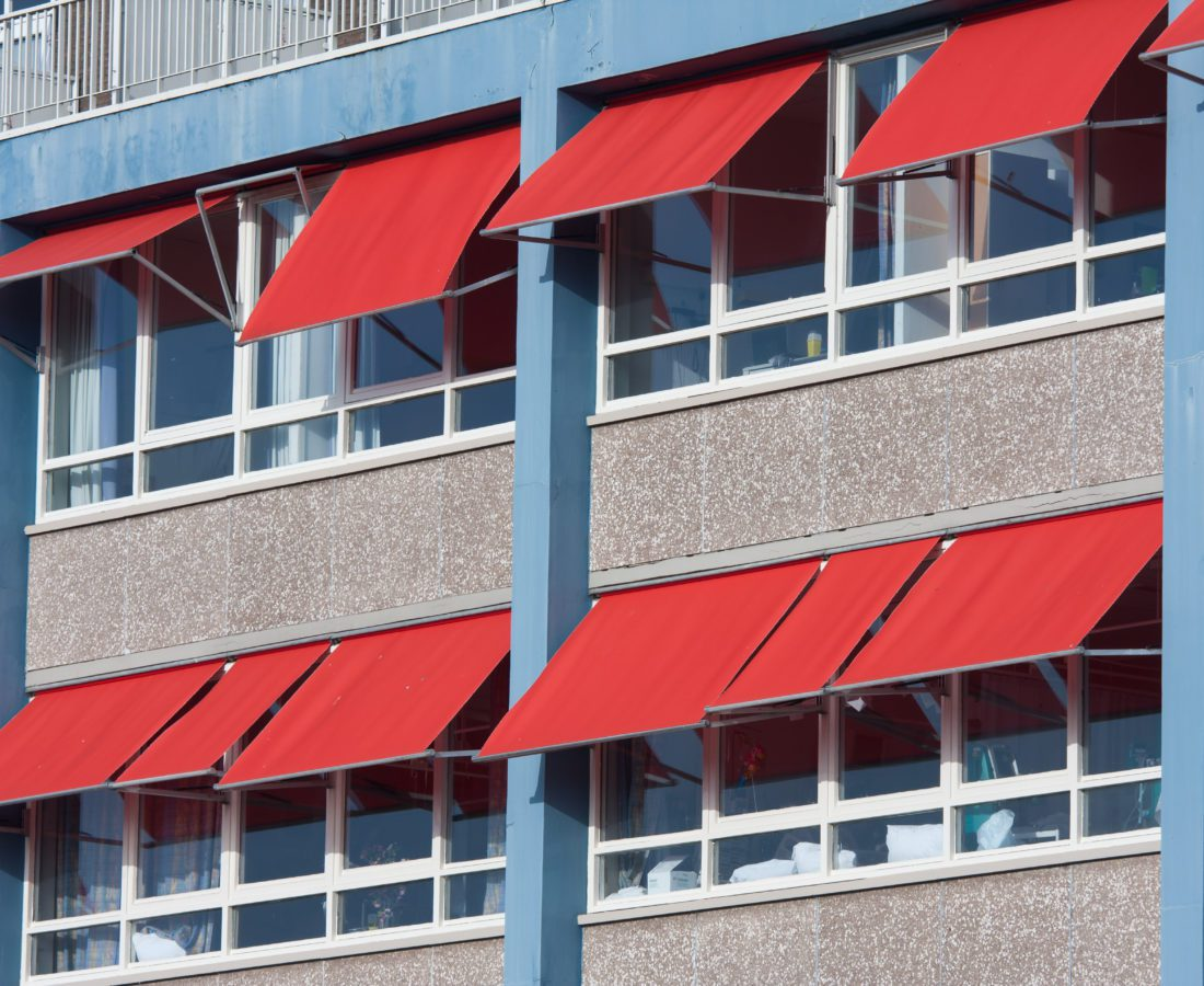 Facade of a modern building with red sunshades
